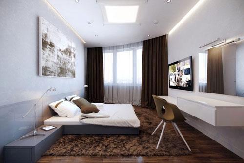 Белый цвет в интерьере гостиной с темными занавесками.
