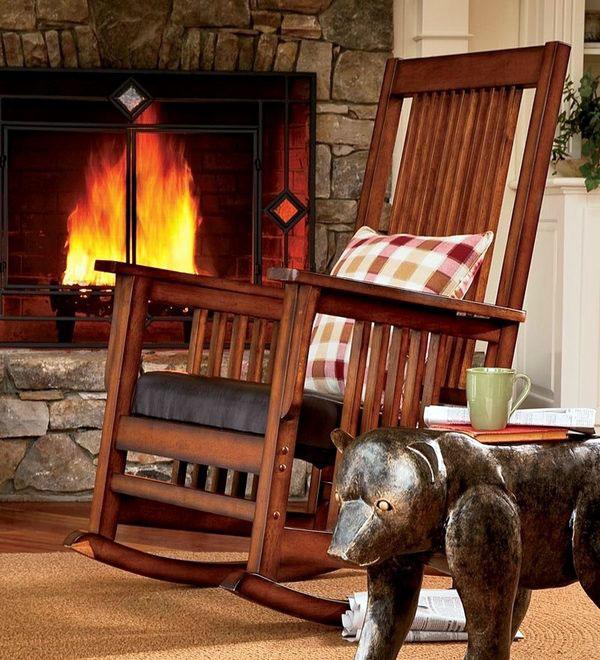 Лоджия, декор, деревянное кресло-качалка, оригинальный журнальный столик.