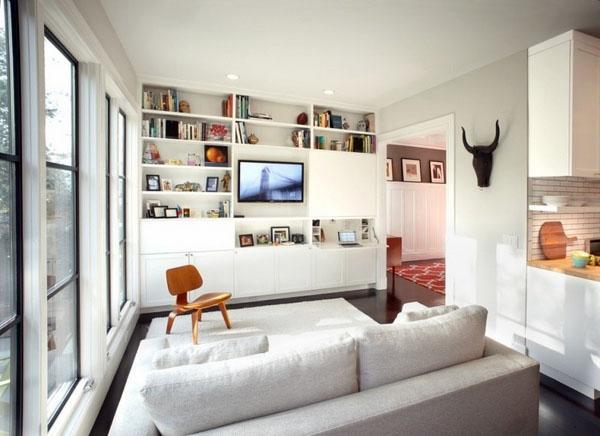 Современный дизайн интерьера, небольшой диван, белая мебель.