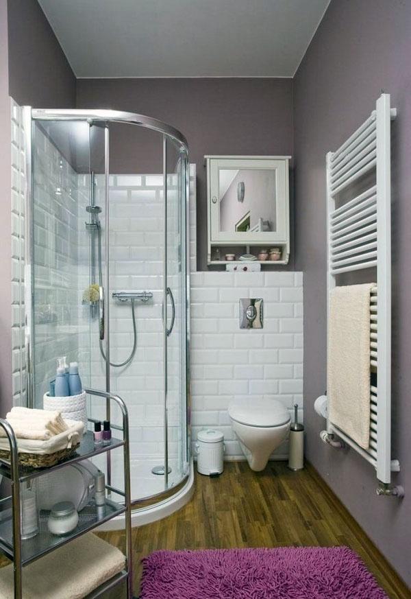 угловая душевая в ванной комнате, пол из черепицы.