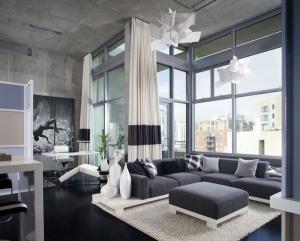 Современные идеи бетонные стены большой серый угловой диван