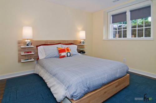 Минималистский дизайн спальни с каменной стеной глянцевая напольная плитка